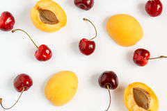 Cherry and apricot on a white background. Royalty Free Stock Photography
