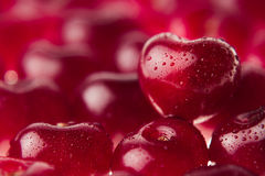 Cherry background with cherry in form of heart. Ripe fresh rich cherries with drops of water. Stock Images