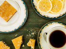 Cherry Bakewell Cake Slices With Black Lemon Tea. Against A Green Wooden Background Stock Photography