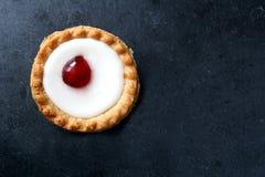 Cherry Bakewell Tart In Foil Case On Dark Background Stock Photo