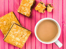 Cherry Bakewell Tarts With a Cup or Mug of Tea or Coffee Stock Image