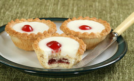 Cherry bakewells on a plate Royalty Free Stock Image