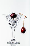Cherry berries in a martini glass on white background. Toned Royalty Free Stock Photo