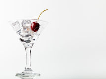 Cherry berries in a martini glass on white background. Toned Royalty Free Stock Image