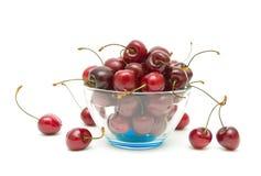Cherry berries on a white background. horizontal photo. Royalty Free Stock Photo