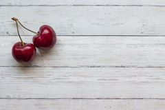 Cherry berries on a wooden background top view, close-up royalty free stock photo