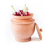 Cherry berries in wooden bowl Royalty Free Stock Photography