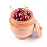 Cherry berries in wooden bowl Stock Images