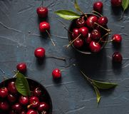 cherry berry red bowl dark background skate summer fresh top view royalty free stock photography