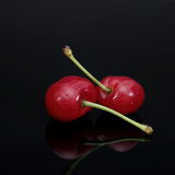 Cherry on black background Royalty Free Stock Photos