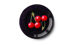 Cherry on the black plate Stock Photos