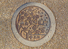 Cherry Blossom Manhole cover at Ueno Park in Tokyo Stock Image