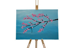Cherry blossom painting. Painting of cherry blossoms on easel Royalty Free Stock Photo