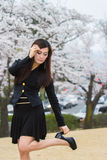 Cherry Blossom with woman. Holding shoes Stock Photography