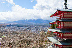 Cherry Blossoms and Pagoda near hidden Mt. Fuji Royalty Free Stock Photography