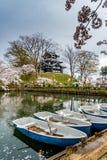 Takada Sakura cherry blossoms boats in pond royalty free stock photo