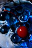 Cherry on The Blue Stock Image