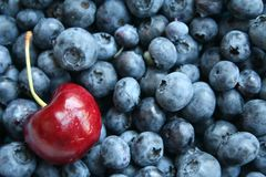 Cherry and blueberry royalty free stock images