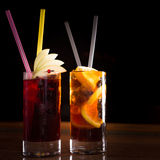 Cherry bomb and cuba libre cocktails in a tall glasses Royalty Free Stock Photos
