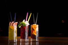 Cherry bomb, screwdriver and cuba libre cocktails in a tall glas Stock Image