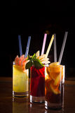 Cherry bomb, screwdriver and cuba libre cocktails in a tall glas Royalty Free Stock Images