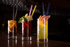 Cherry bomb, screwdriver and cuba libre cocktails in a tall glas Stock Photo