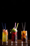 Cherry bomb, screwdriver and cuba libre cocktails in a tall glas Stock Photography