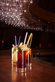 Cherry bomb, screwdriver and cuba libre cocktails in a tall glas Stock Photos