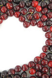 Cherry border. In shape of heart on white background Royalty Free Stock Images