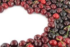 Cherry border. In shape of heart on white background Stock Image