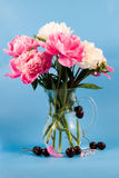 Cherry and bouquet of flowers Stock Photos