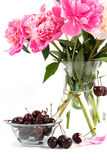 Cherry and bouquet of flowers Stock Photo