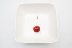 Cherry in bowl Stock Images