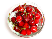 Cherry bowl. Fresh cherries in a glass bowl filled with water Royalty Free Stock Image