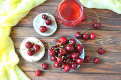 Cherry in a bowl and compote on the table Royalty Free Stock Photos