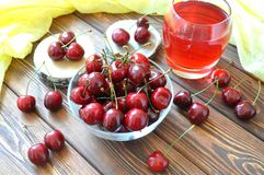 Cherry in a bowl and compote on the table Stock Photography