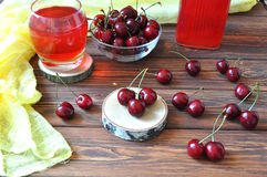 Cherry in a bowl and compote on a wooden table Stock Photo