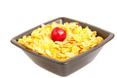 Cherry in a bowl with cornflakes Stock Photography