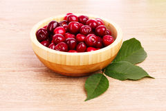 Cherry in bowl on wooden Royalty Free Stock Photography