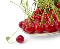Cherry with a branch on a dish Royalty Free Stock Photos