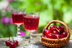Cherry Brandy And Ripe Berries Stock Photos