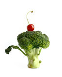Cherry on broccoli. Isolated in white Royalty Free Stock Photos