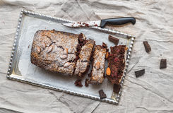 Cherry brownie with almond and dark chocolate cut into pieces on Royalty Free Stock Photos