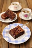 Cherry brownie with black tea. On wooden background Stock Image