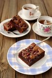 Cherry brownie with black tea. On wooden background Stock Images