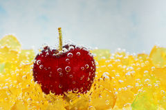 Cherry with bubbles on a blue background Royalty Free Stock Photo