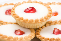 Cherry Cake. Cherry bakewell cakes  on white plate Royalty Free Stock Photos