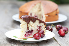 Cherry cake chocolate glaze Royalty Free Stock Image