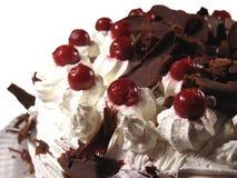 Cherry cake close up. Cherry cake with chocolate and cream close up Royalty Free Stock Photo