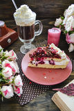 Cherry cake with coffee. Cherry cake with whipped cream and chocolate on the Valentine`s Day, coffee, retro camera and small roses Stock Photography